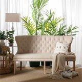 Sofá capitone de lino y madera de caucho
