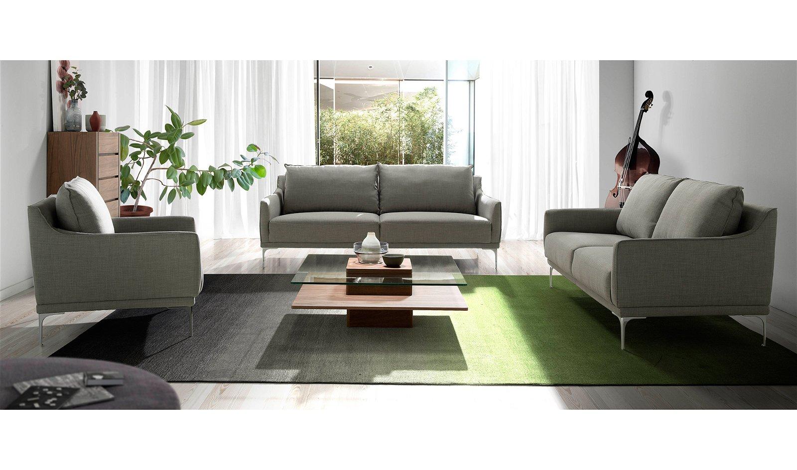 Sofá tapizado en tela patas cromadas Taormina