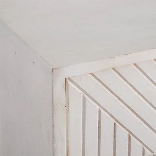 aparador madera blanca con estampado geometrico